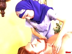 Hijabed babe gives a handjob to a bound dude